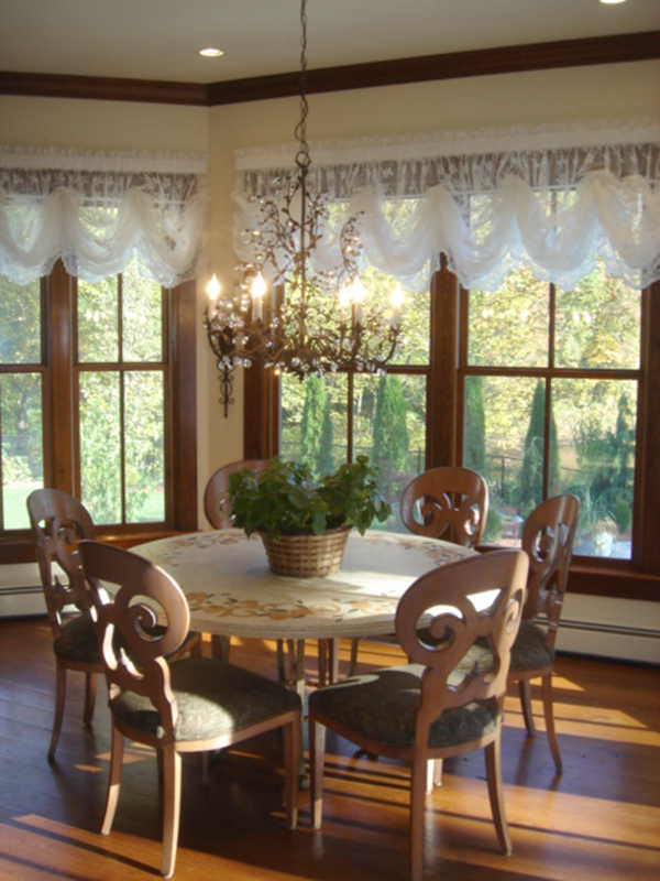 Country kitchen table with luxury chandelier
